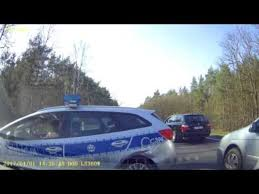 Dashcam Captures Polish Driver's Collision With Police Car