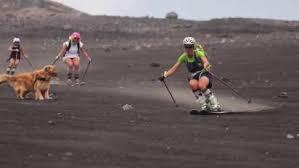 Women Go Sand Skiing On The Flanks Of Mount Etna